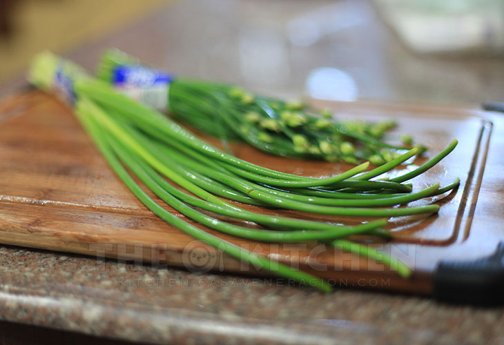 A bunch of fresh garlic scapes