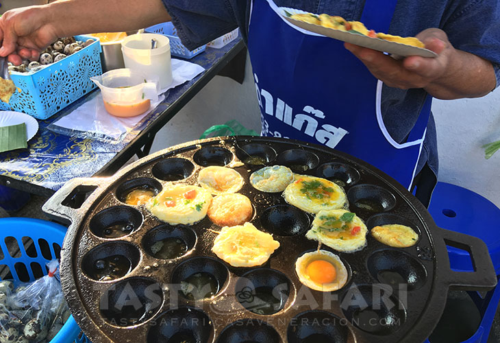 Cooking fried quail eggs and omelet, Chiang Mai Sunday Walking Street