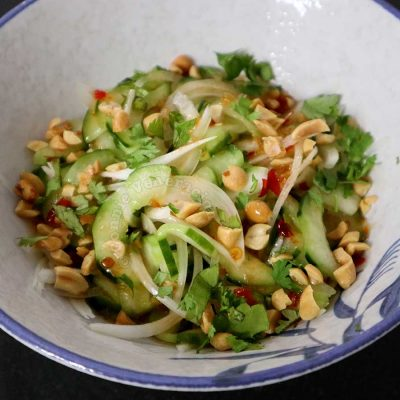Thai cucumber salad garnished with peanuts and cilantro