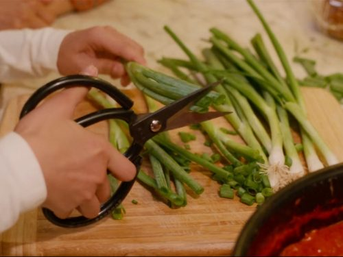 "Cutting scallions with scissors in ""Always Be My Maybe"" 