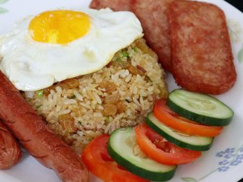 A plate of American fried rice with egg, hotdogs and fried SPAM