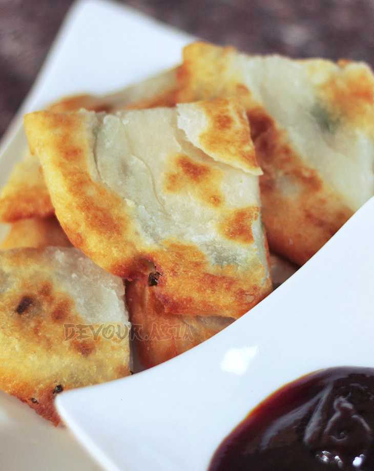 Chinese scallion pancakes cut into triangles