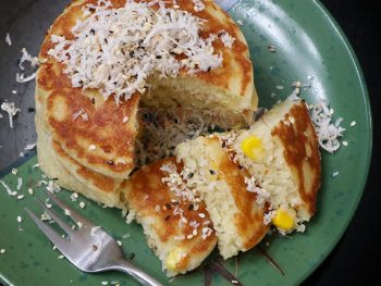 Pancakes made with coconut milk topped with grated coconut and sesame seeds