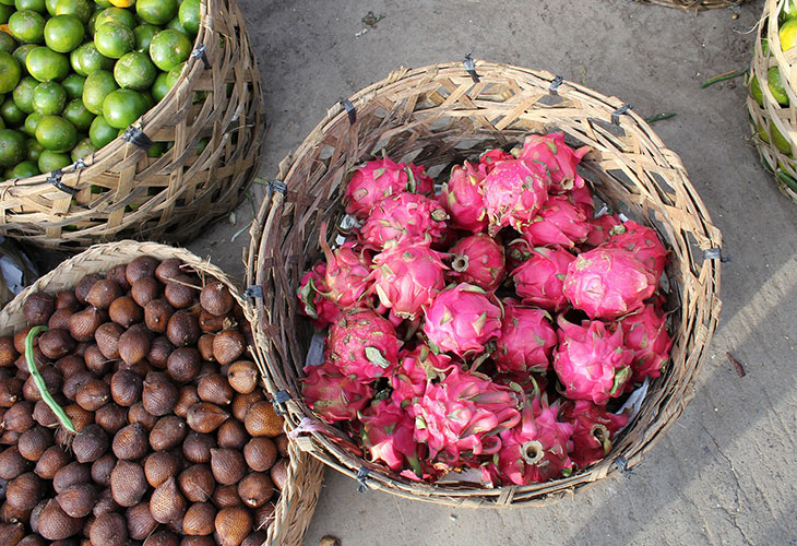 Dragon fruits with magenta skin in a basket