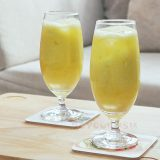 Two glasses of green mango juice