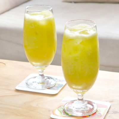 Two glasses of homemade green mango juice