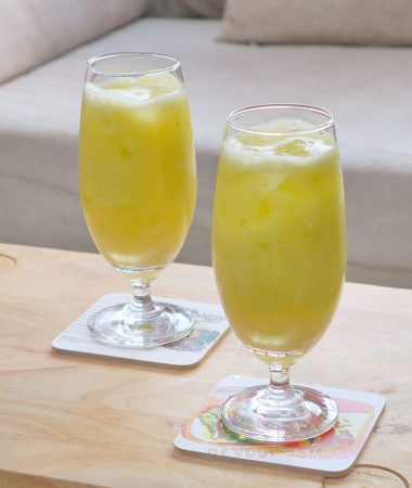 Glasses of fresh green mango juice