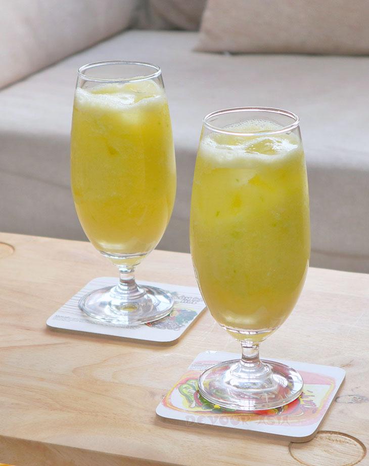 Glasses of fresh green mango juice