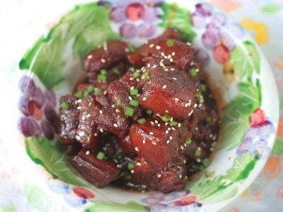 Chinese Red-braised Pork Belly (Hong Shao Rou) Garnished with Scallions and Sesame Seeds