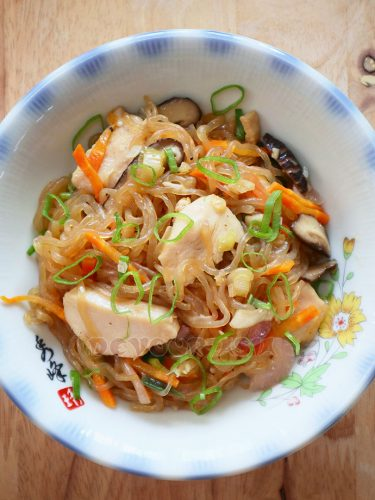 Stir fried shirataki, chicken, shiitake and vegetables in a bowl