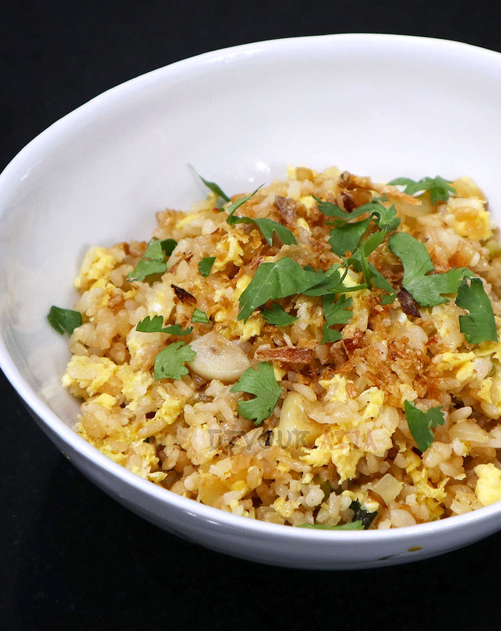 Thai fried rice sprinkled with torn cilantro