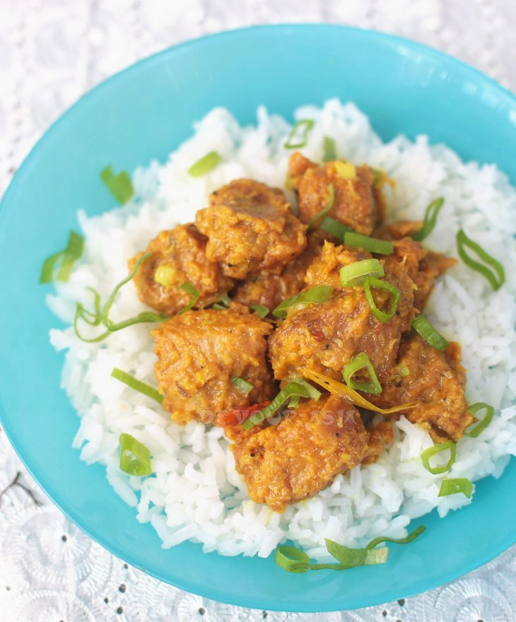 Pork rendang over rice in blue bowl