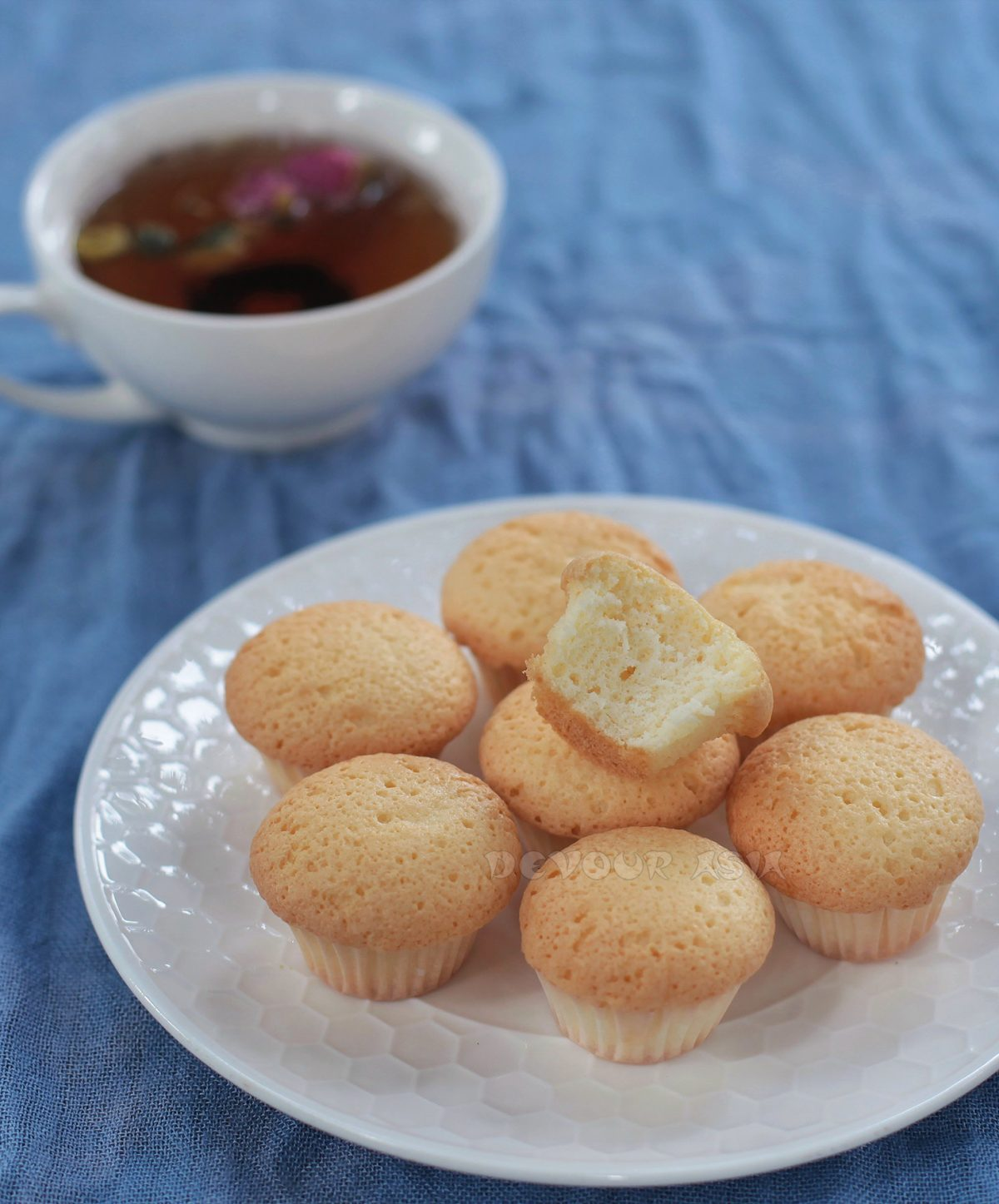 A plate of Chinese egg cakes and a cup of tea