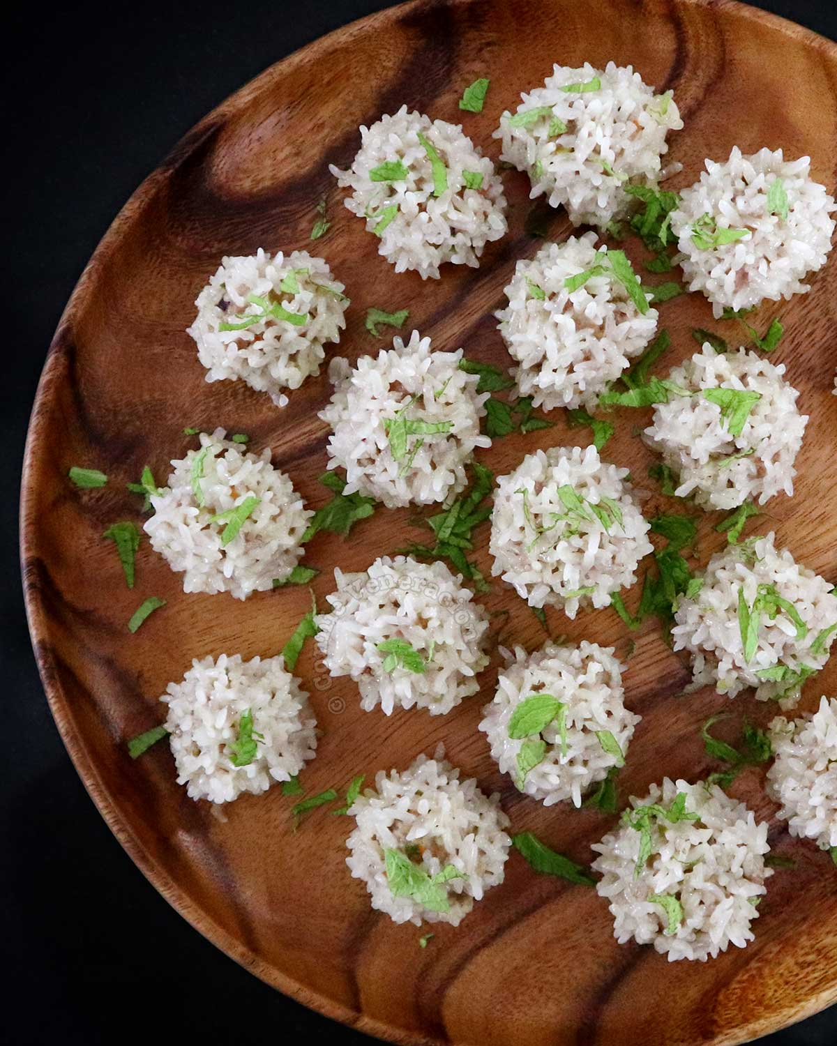 Chinese sticky rice balls on wooden platter