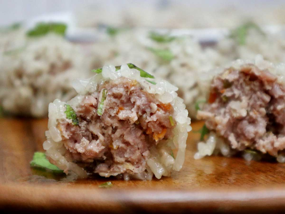 Cross-cut of Chinese sticky rice ball showing meat filling