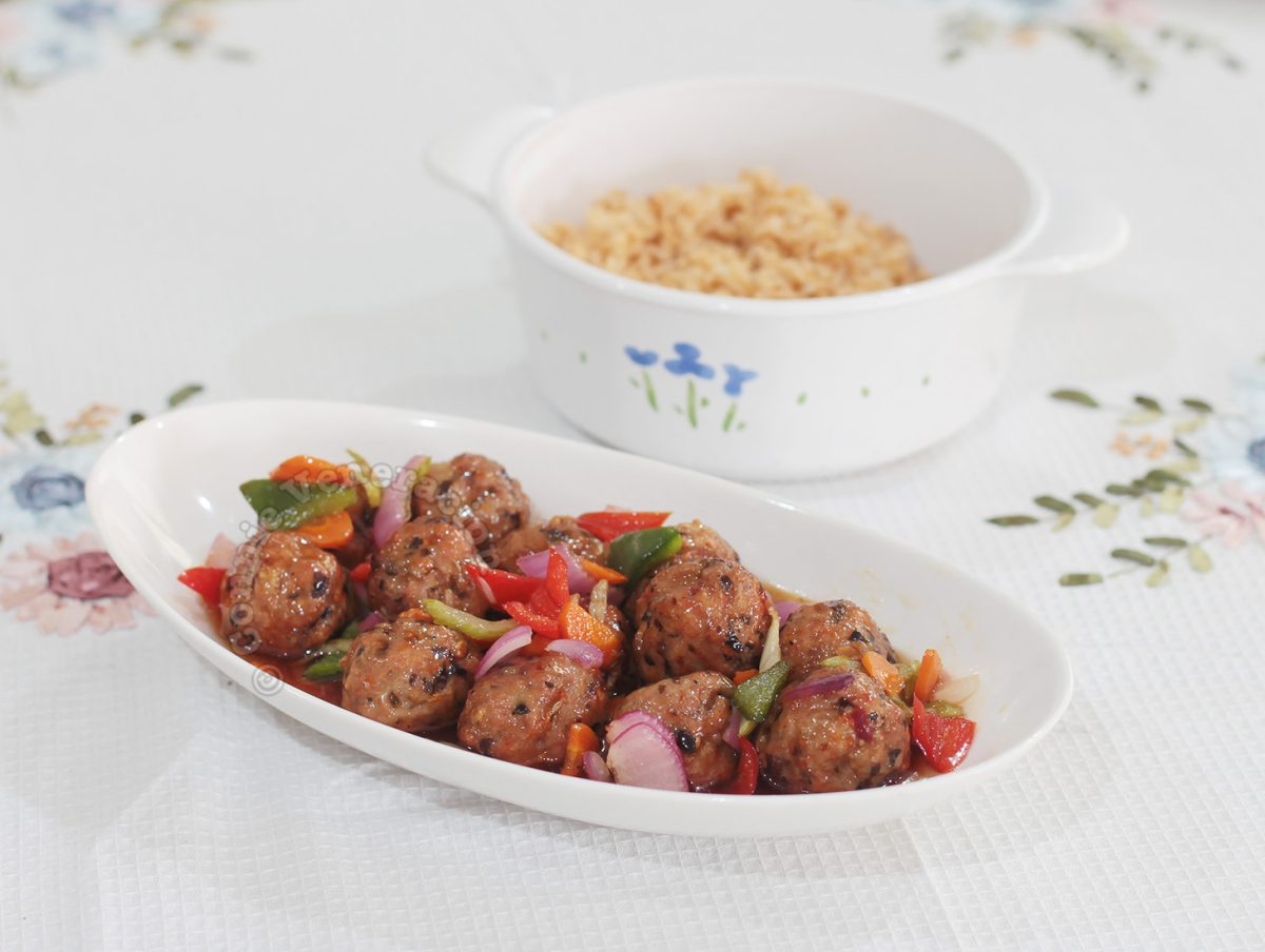 Sweet and sour meatballs with rice on the side