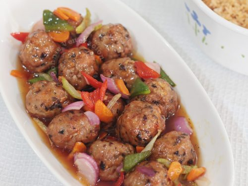 Sweet and Sour Meatballs with Onion Slices and Bell Pepper