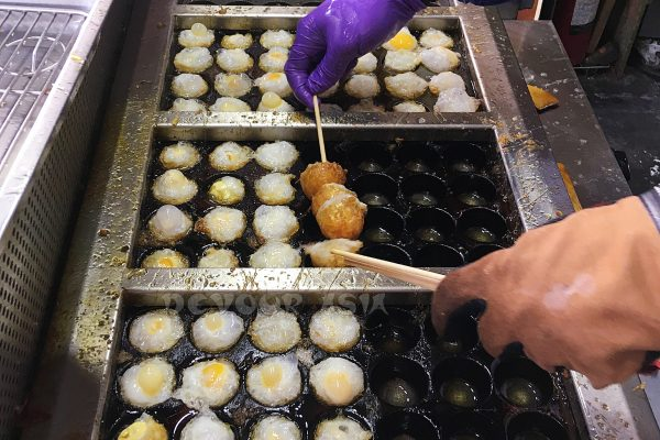 Fried and skewered quail eggs. Tamsui Old Street, Taiwan