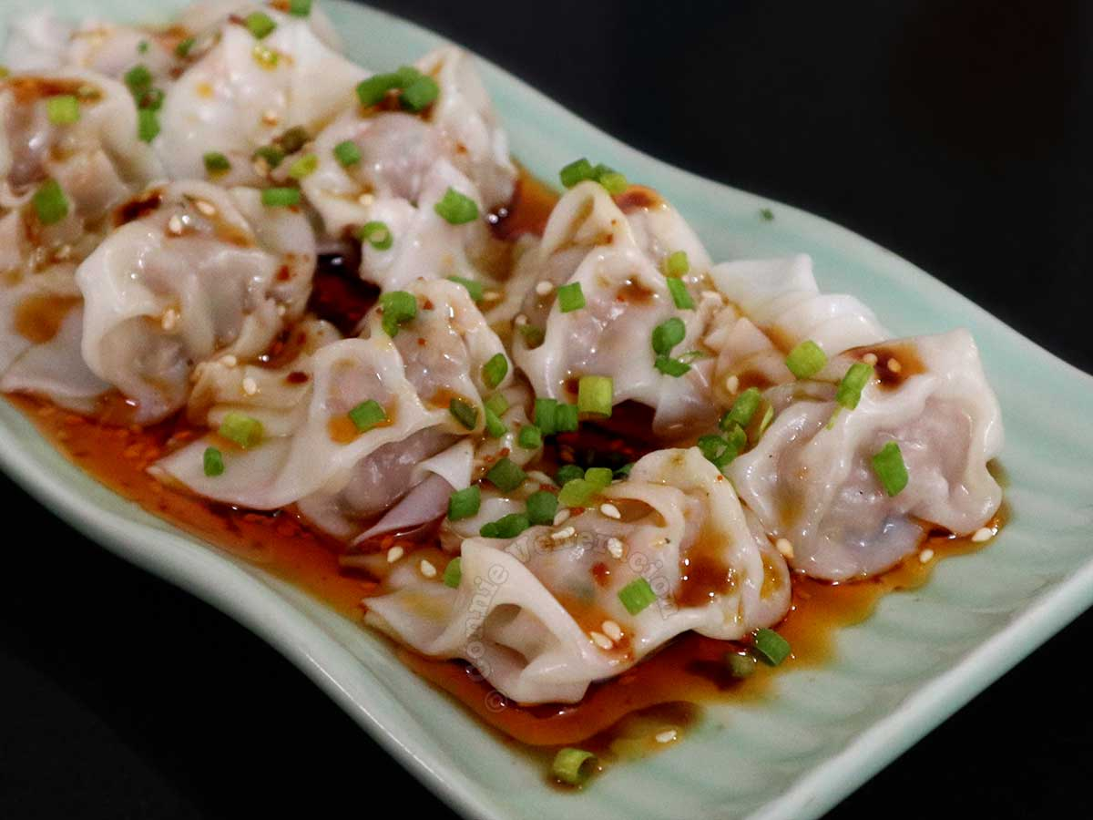 Wontons in Sichuan Chili Oil Sprinkled with Scallions and Sesame Seeds