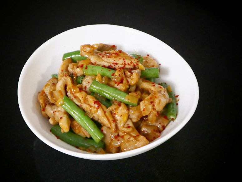 Chicken and Green Beans Stir Fry in White Bowl on Black Background