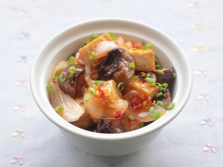 A bowl of Mushrooms and tofu with lemongrass-infused sweet chili sauce