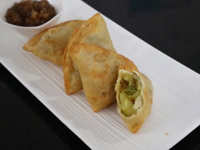 Home cooked samosas with spicy potato and pea filling