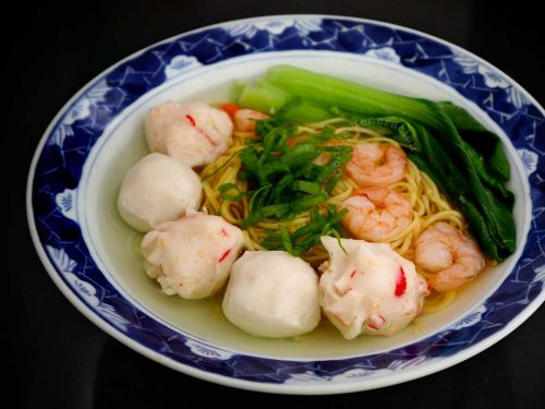 Noodle soup with whole shrimps, cuttlefish balls, lobster balls and bok choy