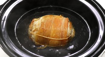 Braising browned pork belly to make chashu
