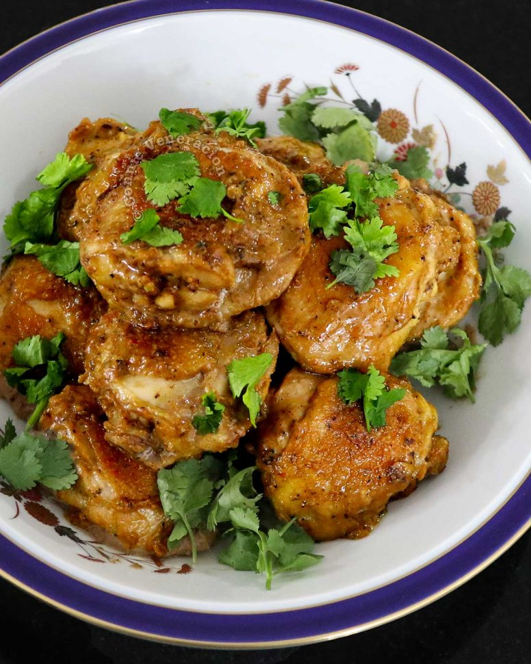 Yogurt marinated chicken garam masala in serving bowl