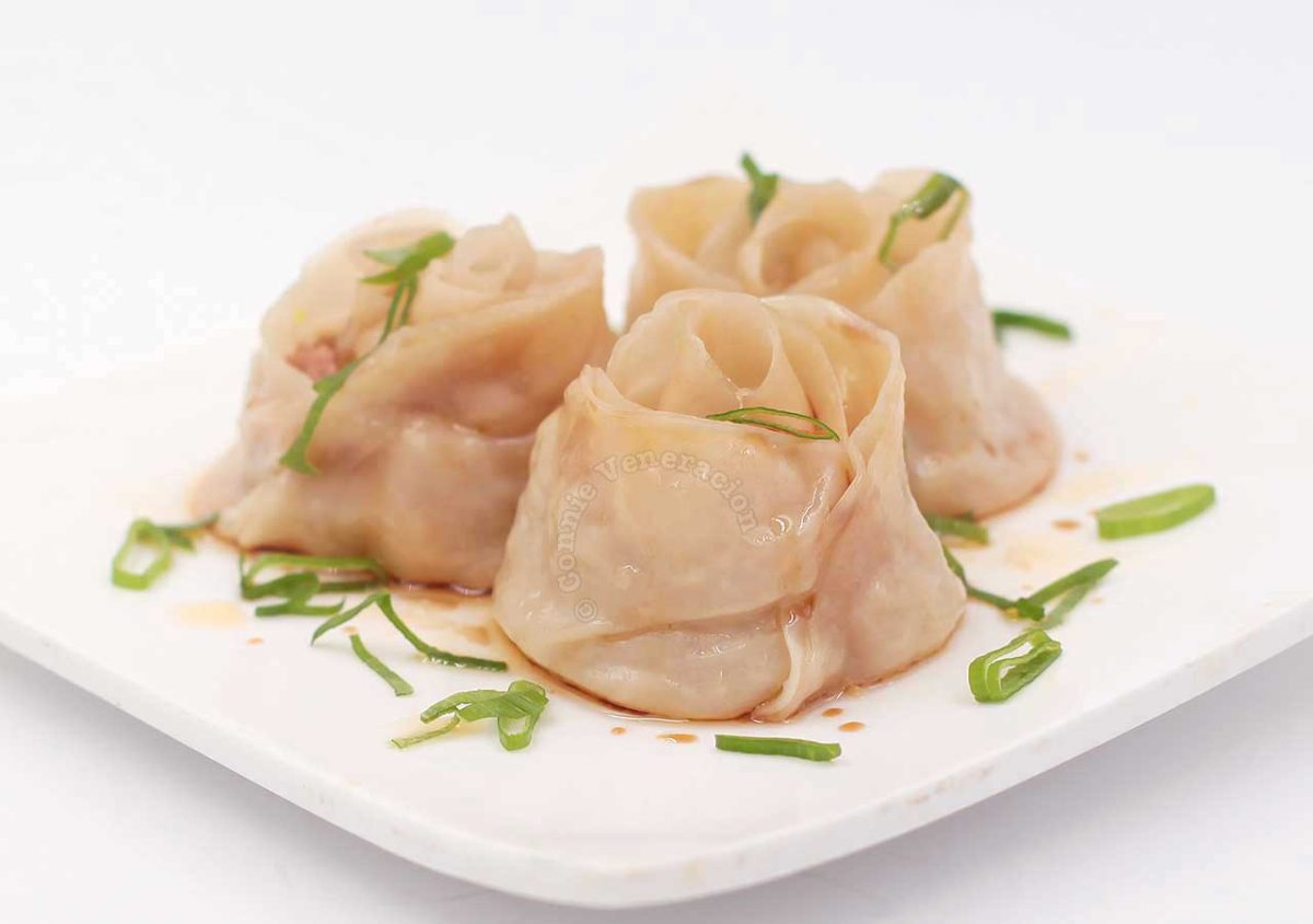Rose Dumplings Drizzled with Soy Sauce and Sesame Seed Oil, and Garnished with Sliced Scallions