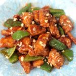 Fried chicken fillet cubes tossed with chili sauce