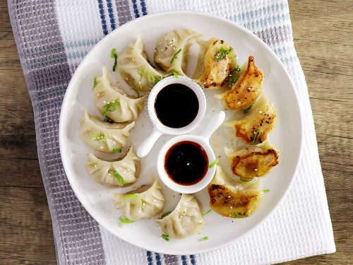 Gyoza (top and bottom shown) with dipping sauces