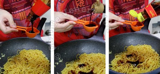 Adding soy sauce, oyster sauce and fish sauce to garlic noodles