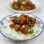 General Tso's Chicken Served over rice sprinkled with scallions ans sesame seeds