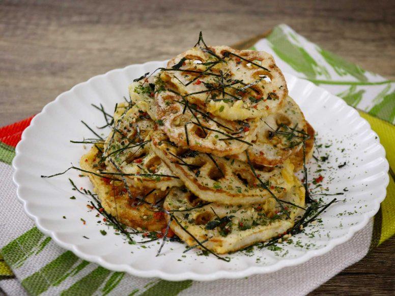 Lotus root tempura sprinkled with nori strips, aonori and furikake