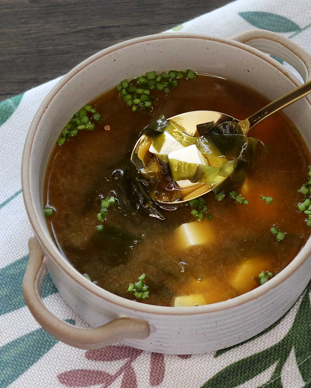 A bowl of miso soup with wakame and soft tofu