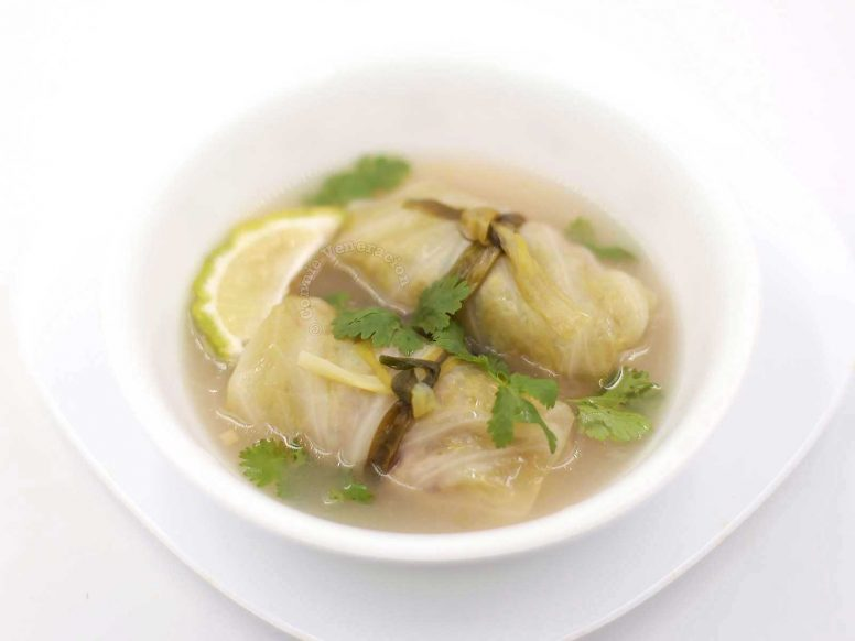 Cabbage rolls soup, Thai-style, garnished with cilantro and lime wedge