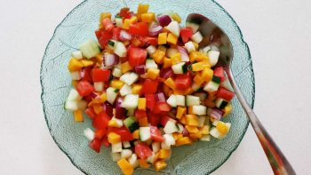 A side salad of tomatoes, cucumbers and mangoes