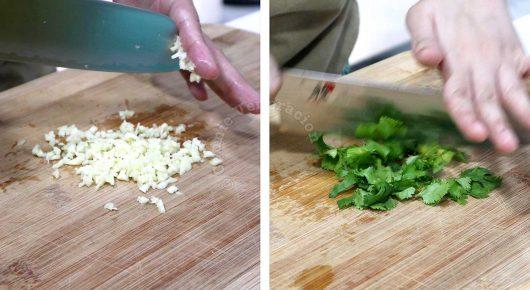Chopping garlic and cilantro on bamboo board