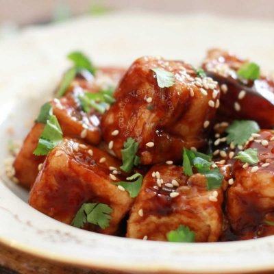 General Tso's Tofu Garnished with Cilantro and Toasted Sesame Seeds
