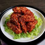 Korean Fried Chicken Wings Served on a Bed of Lettuce