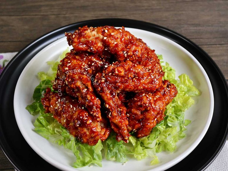 Korean fried chicken wings (spicy!) on a bed of shredded lettuce