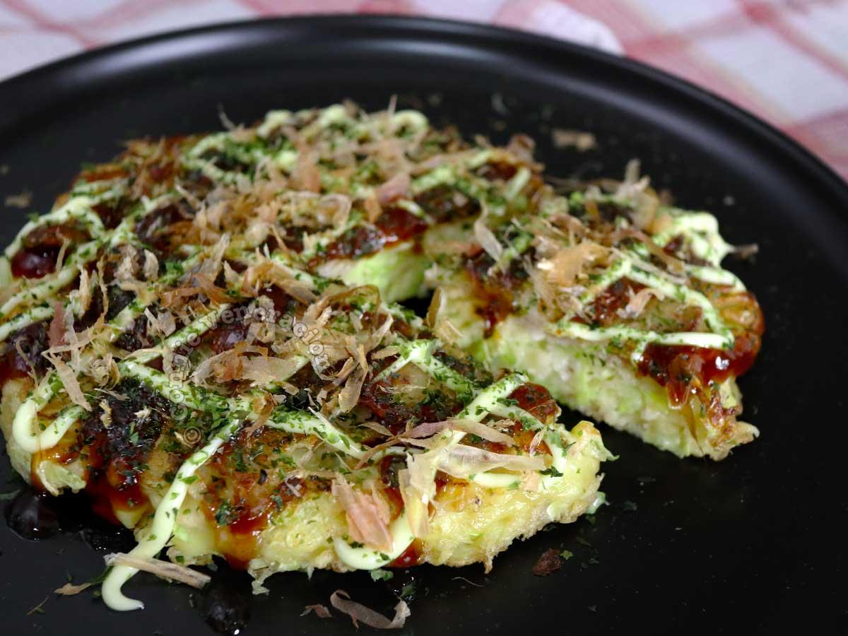 Home cooked okonomiyaki on black plate