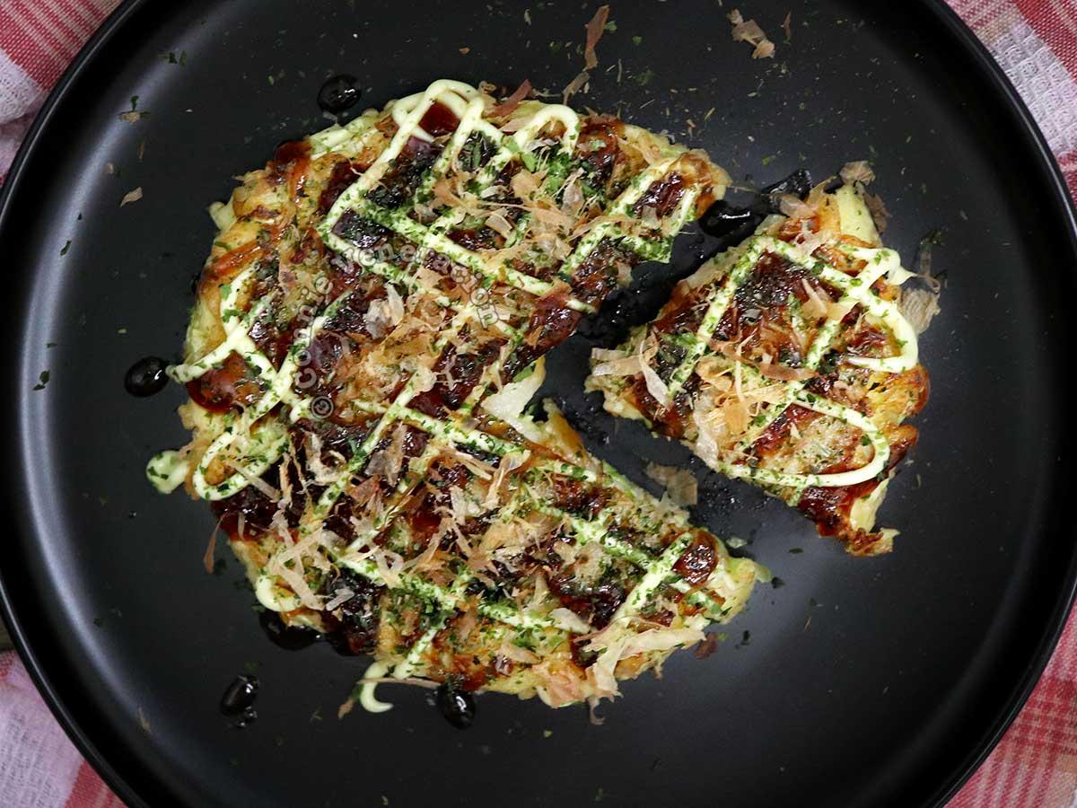 Okonomiyaki garnished with sauce, mayp and aonori