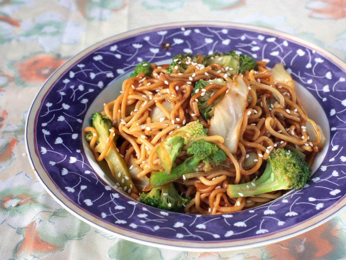 Vegan teriyaki noodles with broccoli florets and cabbage
