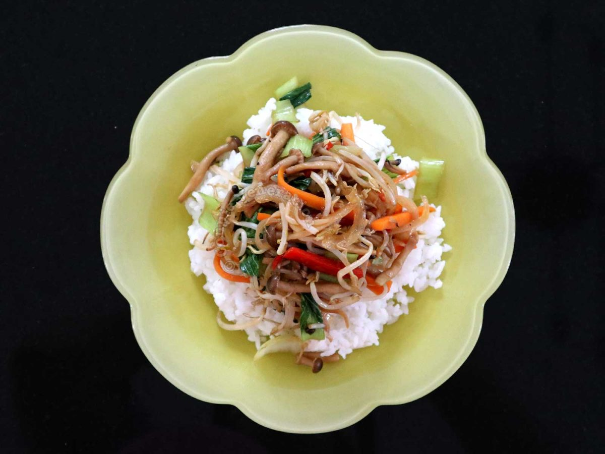 15-minute Mushroom and Vegetable Stir Fry Served Over Rice in Yellow Bowl