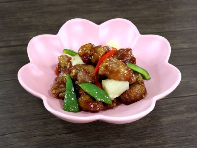 Sweet sour pork in light pink bowl