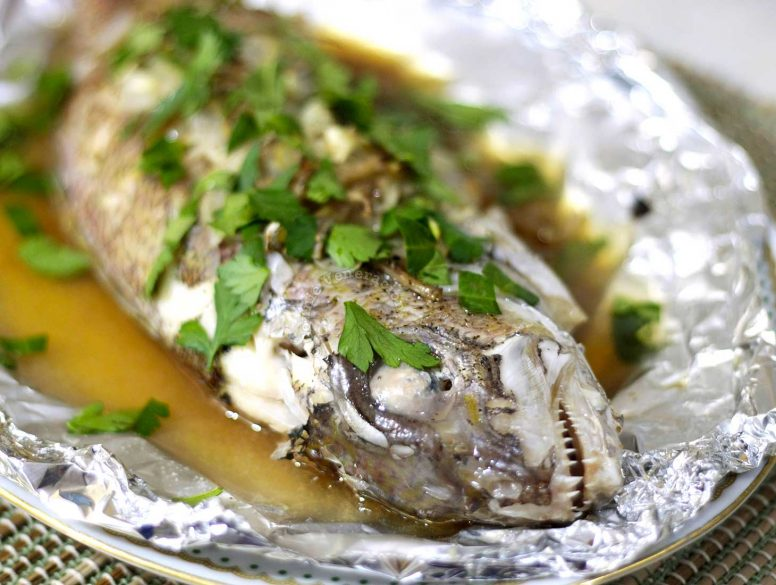 Baked fish with ouster sauce garnished with cilantro