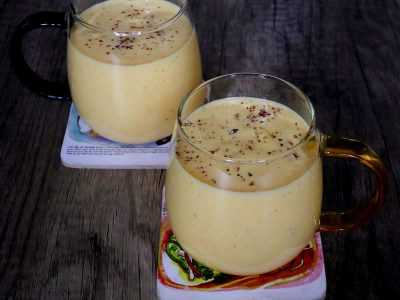 Two mugs of mango lassi