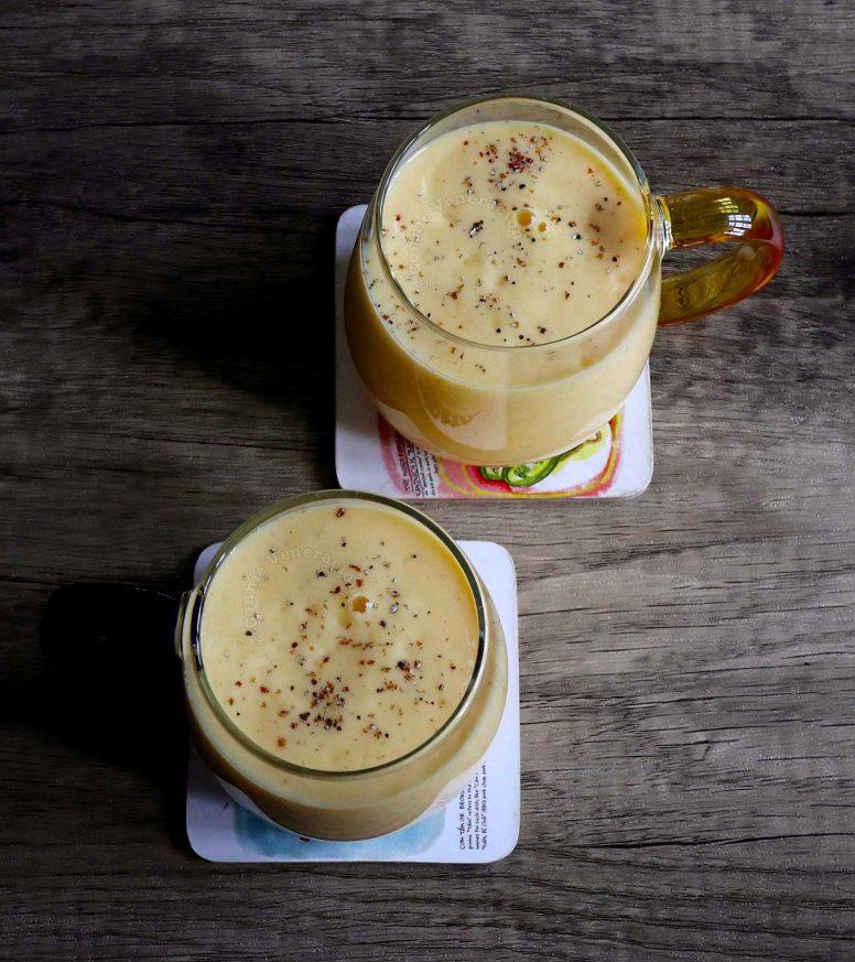 Mango lassi sprinkled with ground cardamom